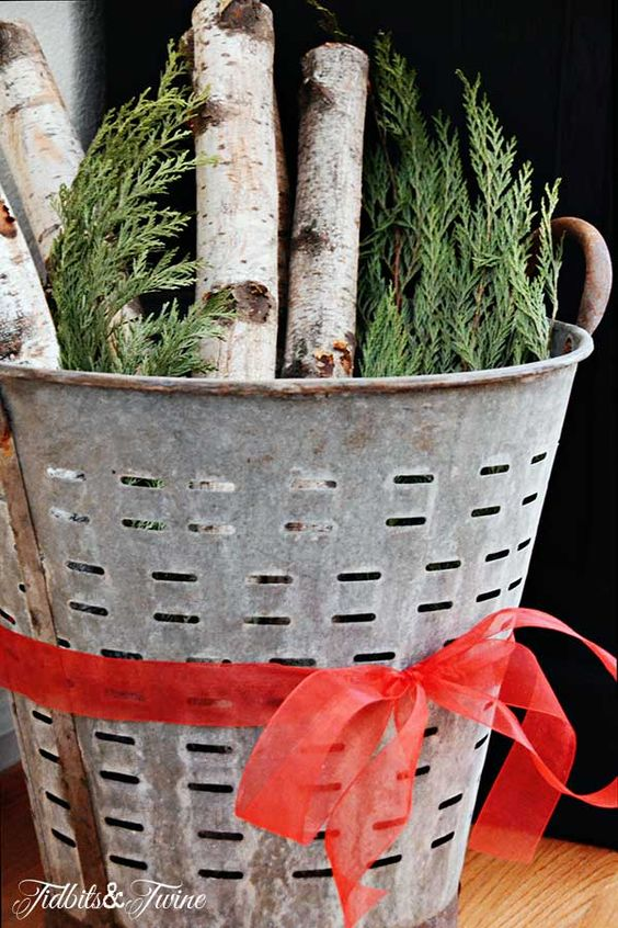vintage olive basket with wood and greens christmas decor