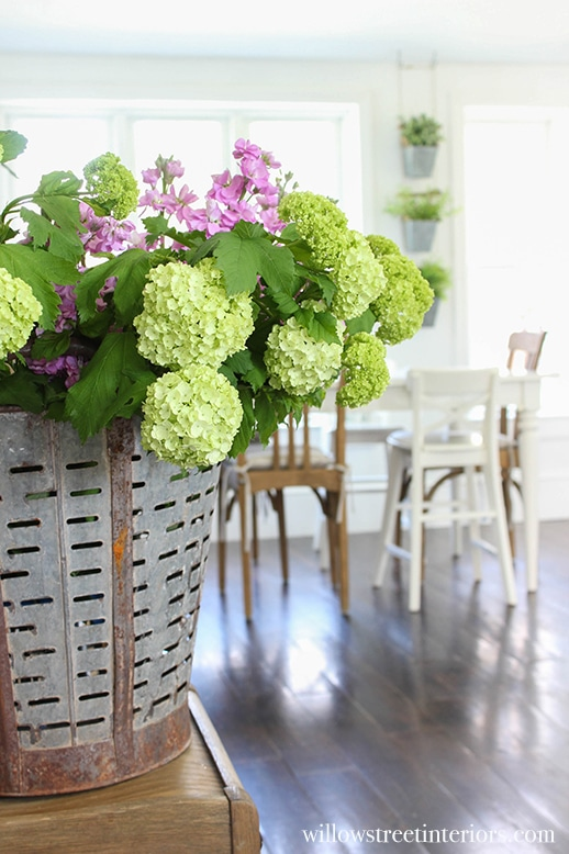gorgeous flowers in vintage olive bucket pretty white kitchen