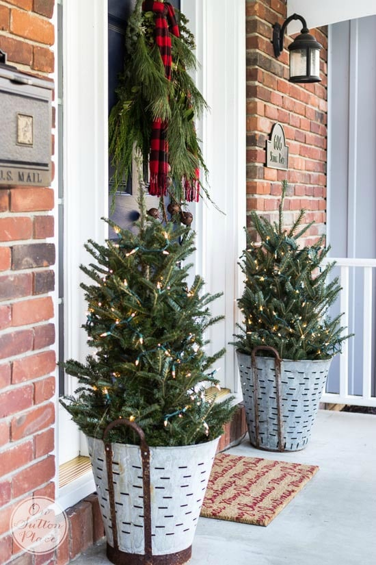 charming olive baskets with Christmas trees holiday porch decor