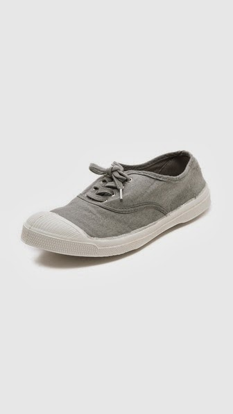 joie de vivre in a gray canvas shoe
