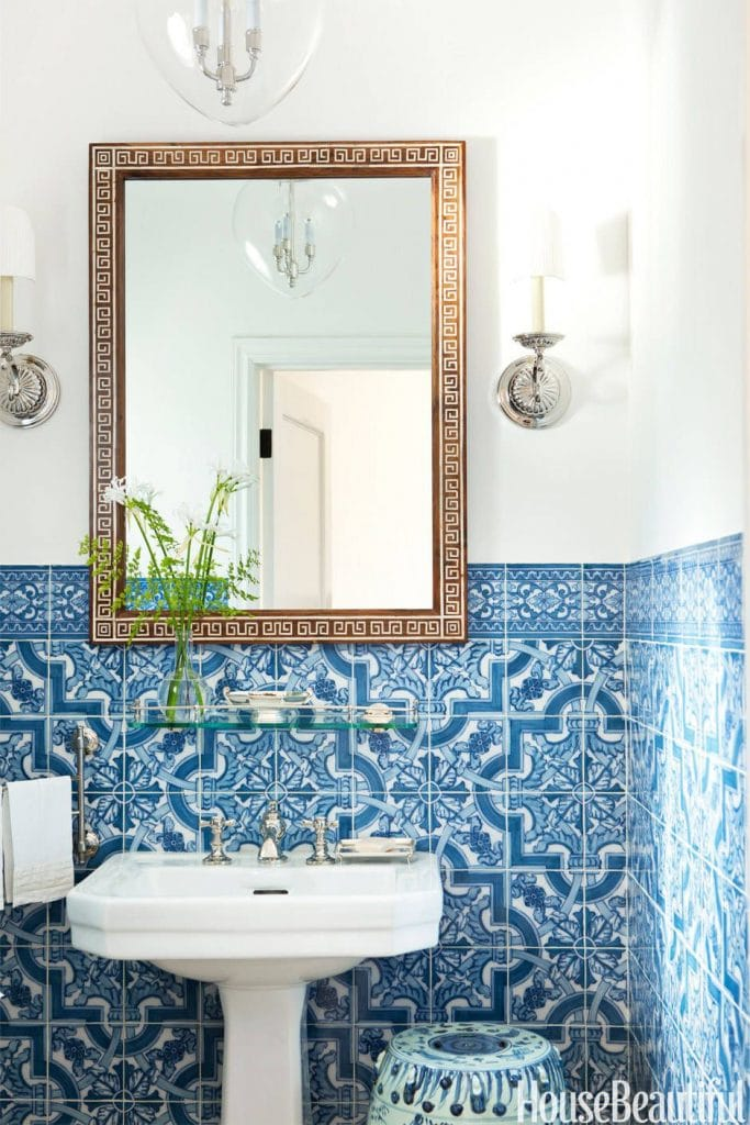 blue and white tile gorgeous powder room pedestal sink gold mirror sconces