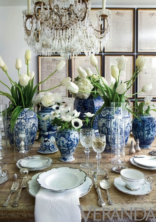 blue and white ginger jars dining table gorgeous tablescape tablesetting antique chandelier artwork