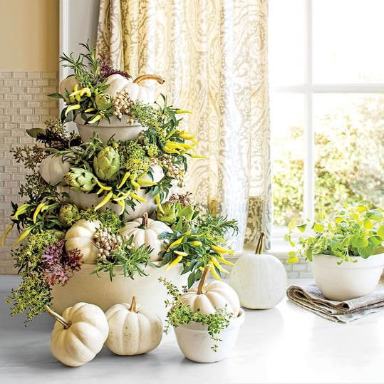 white pumpkins stacked in bowls centerpiece creative fall display
