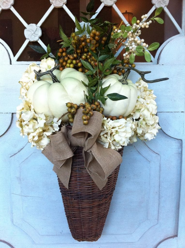 white pumpkins in basket fall door decor with berries and hydrangeas