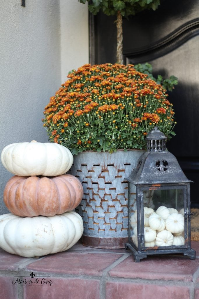 white pumpkins mixed with orange mums fall autumn porch decor