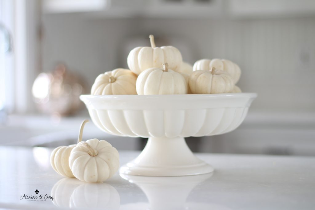 neutral fall decor white pumpkins in white bowl in french country kitchen
