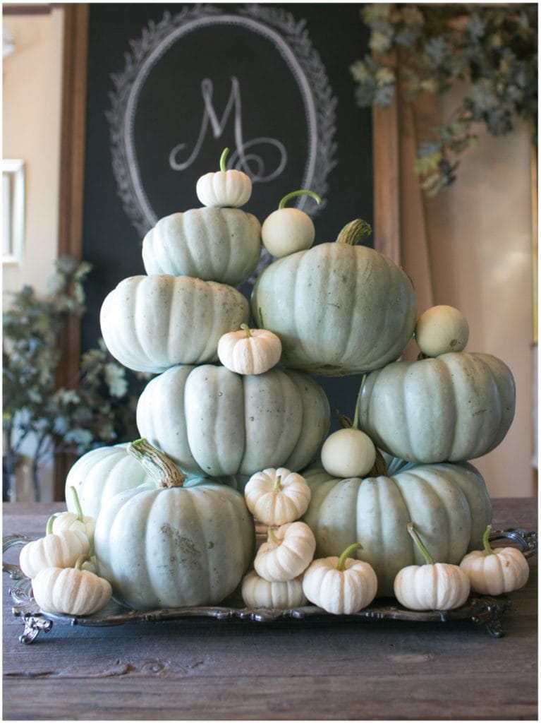 white pumpkins stacked display with blue/green ones gorgeous fall decor