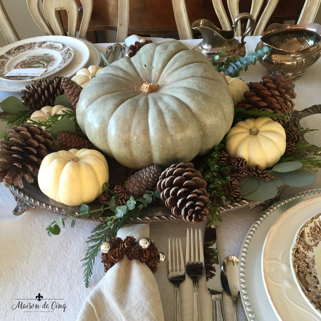 thanksgiving tablescape with white and green pumpkin on silver tray with greens