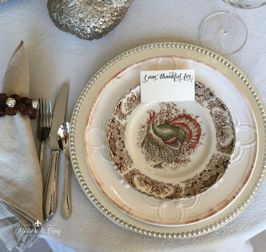 thanksgiving tablescape with vintage turkey plates and linen napkins