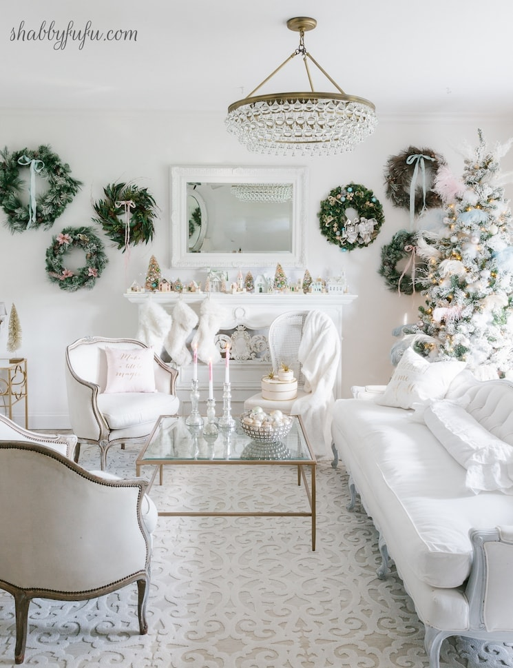 wreaths on wall in French country living room christmas decorating idea