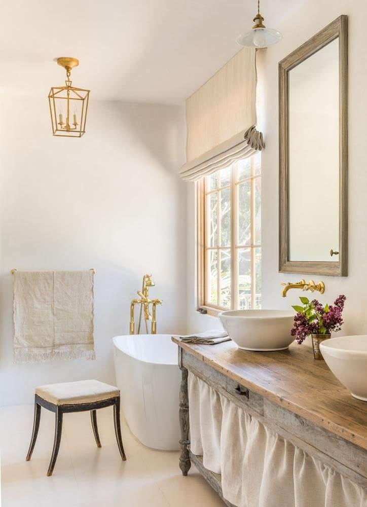 stunning french farmhouse bathroom with gold lantern and fixtures