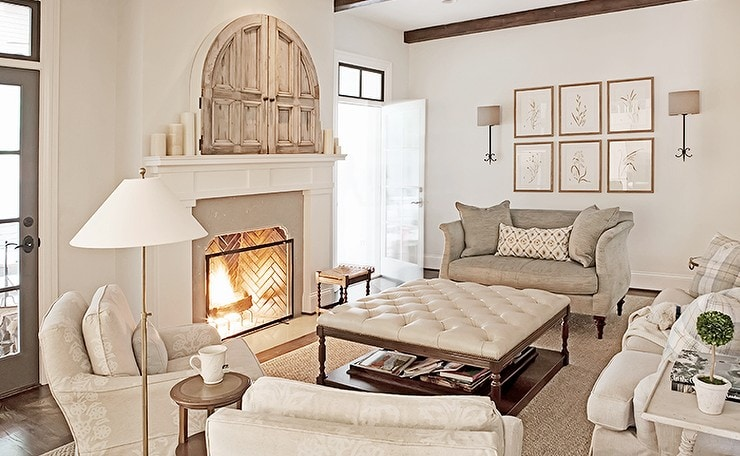 framed botanicals in french country style neutral living room fireplace