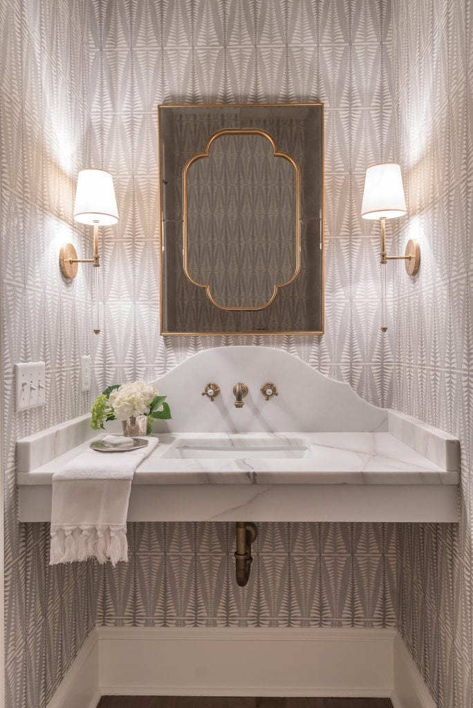 powder room with brass faucet and lighting