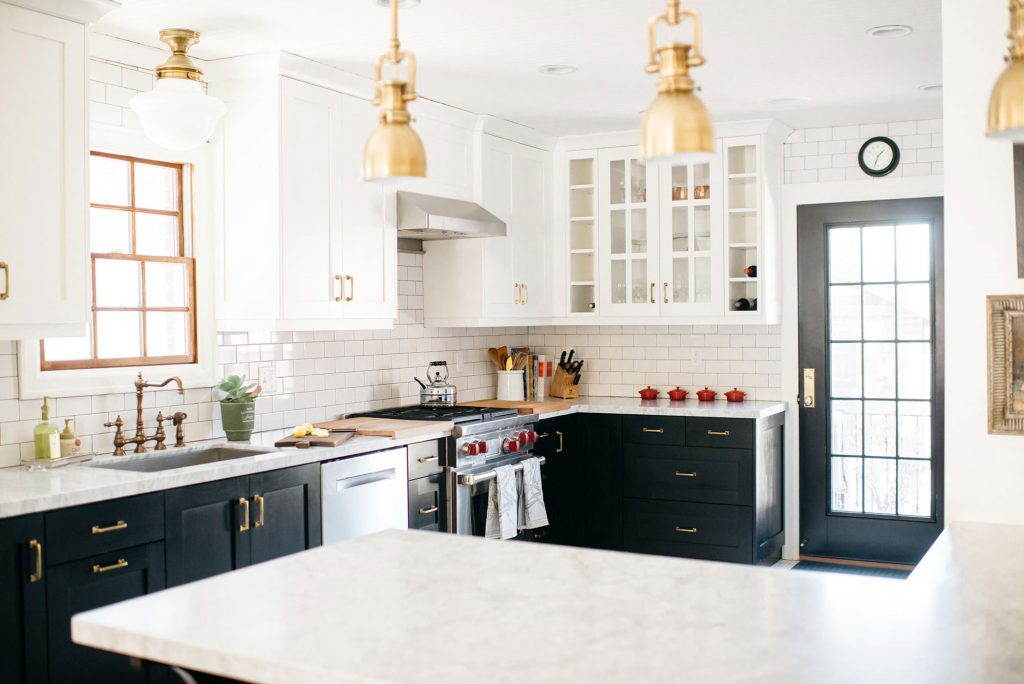 brass lighting in gorgeous black and white kitchen