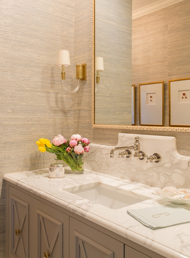 mixed metals in bathroom gold mirror and sconces nickel faucet
