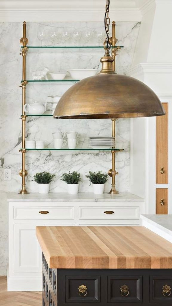 brass lantern in white kitchen marble backsplash open shelves