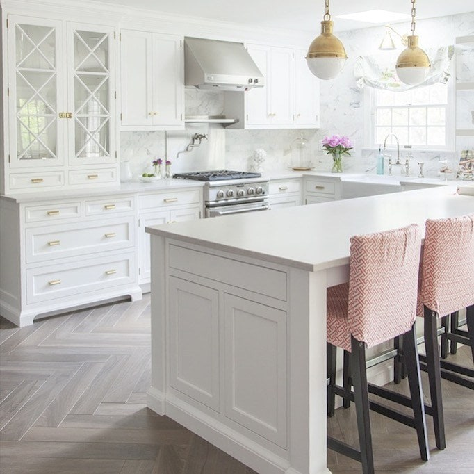 brass hardware trend and lighting in classic gorgeous white kitchen