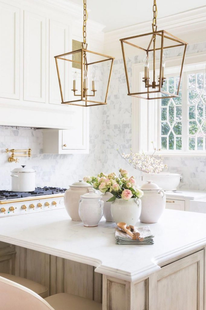 brass hardware trend in white kitchen with gorgeous gold lanterns