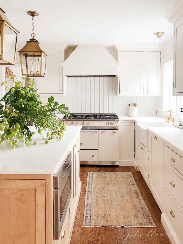 brass hardware trend in white french farmhouse kitchen brass lanterns
