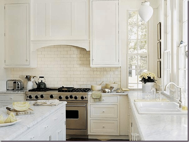 white kitchens subway tile classic style schoolhouse lighting marble counters