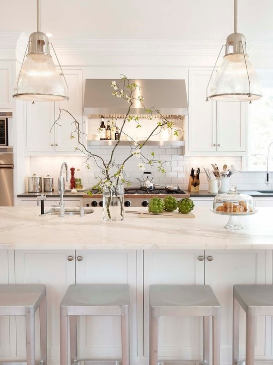 white kitchens stainless hood marble counters pendant lights subway tile metal barstools