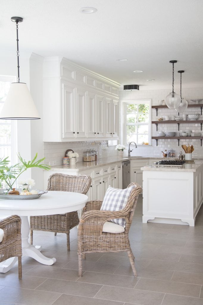 white kitchens glass pendant lights wicker chairs breakfast area open shelves