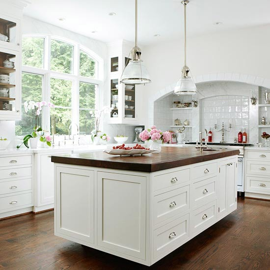 white kitchens butcher block counters glass cabinets white tile backsplash