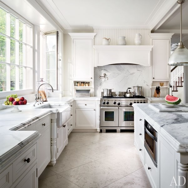 white kitchens mantel hood with white pitchers marble backsplash beadboard