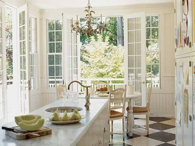 white kitchens marble counters chandelier checkered floor french doors classic style