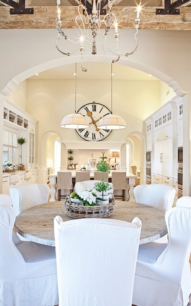 white kitchens farmhouse style gorgeous chandelier oversized clock slipcovered chairs