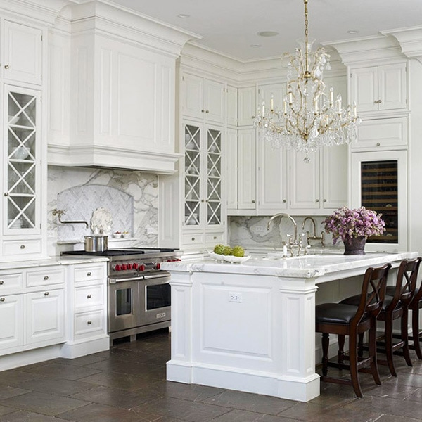 white kitchens dramatic chandelier high ceilings wolf range x-style glass cabinets