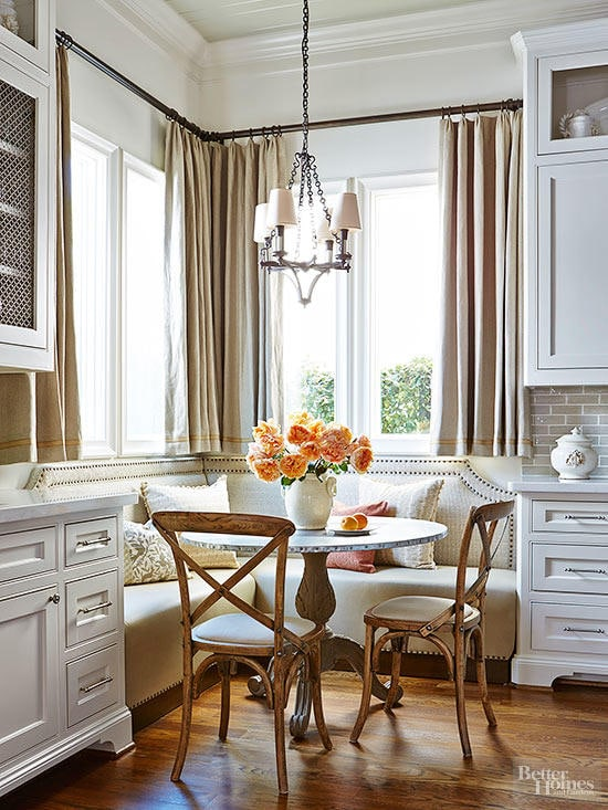 kitchen banquette farmhouse bistro chairs linen curtains white kitchen cabinets charming space
