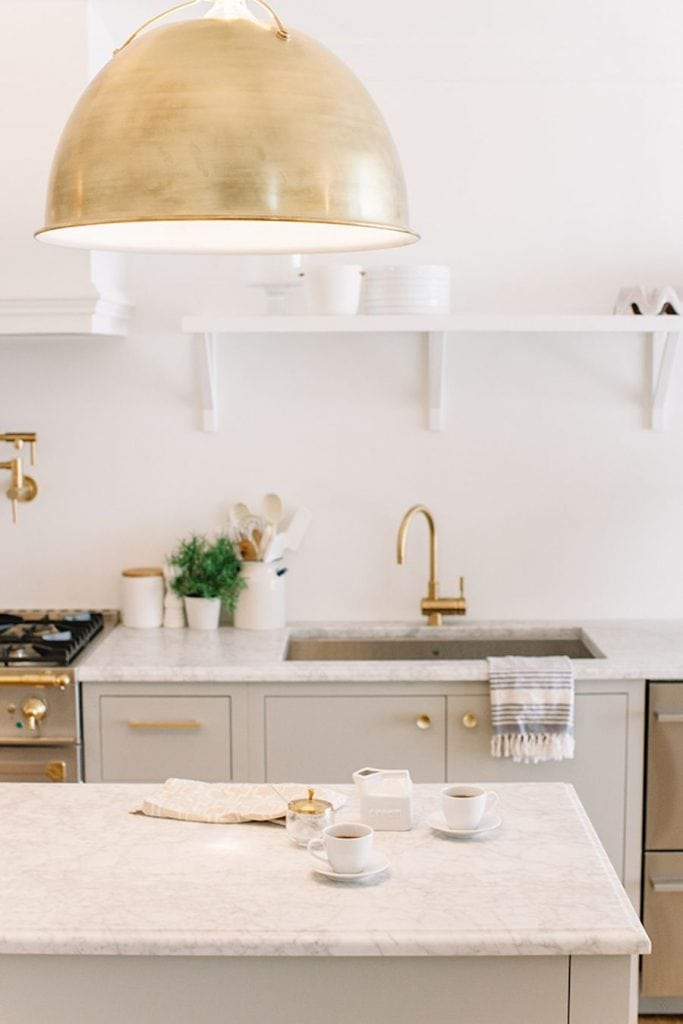 grey and gold kitchen with fabulous pendant light marble counters