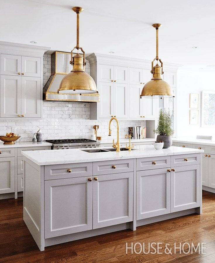 grey and gold kitchen gorgeous hood and antique brass pendants over island