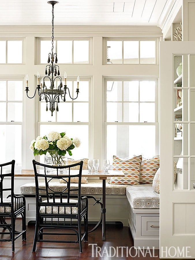 kitchen banquette charming space beautiful chandelier wood windows and built in shelving