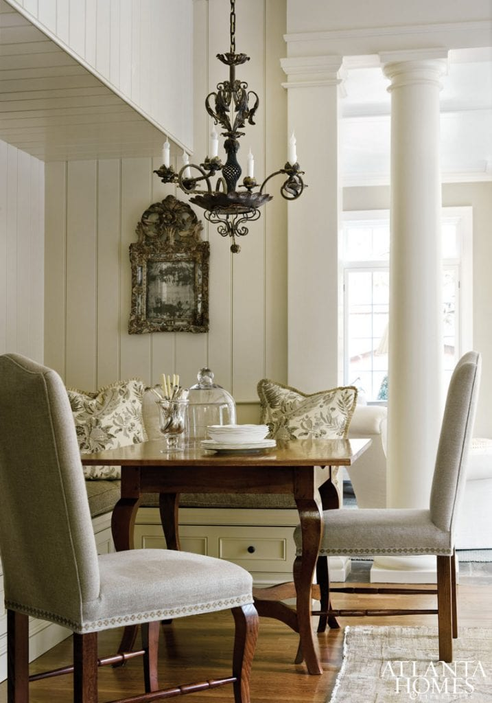 kitchen banquette french country style eat-in kitchen breakfast area gorgeous iron chandelier