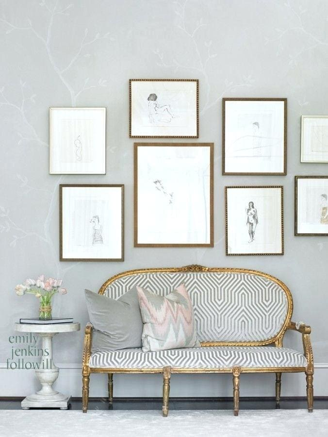 grey and gold entryway wallpaper gallery wall french settee gold frame