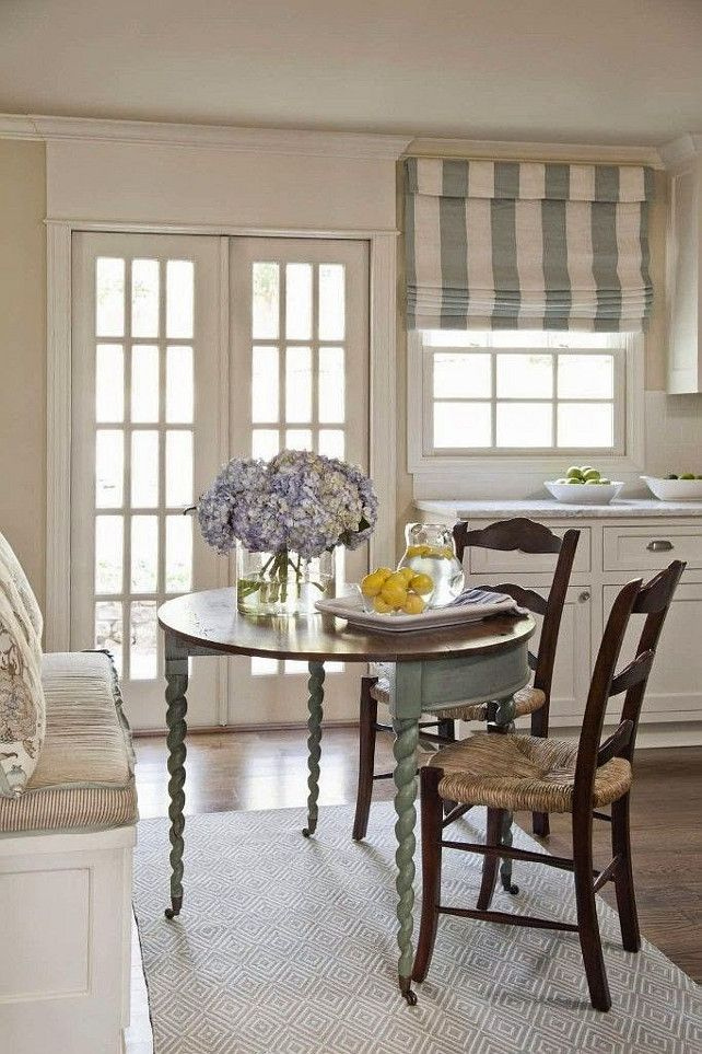 kitchen banquette french country farmhouse style green striped roman shade french doors