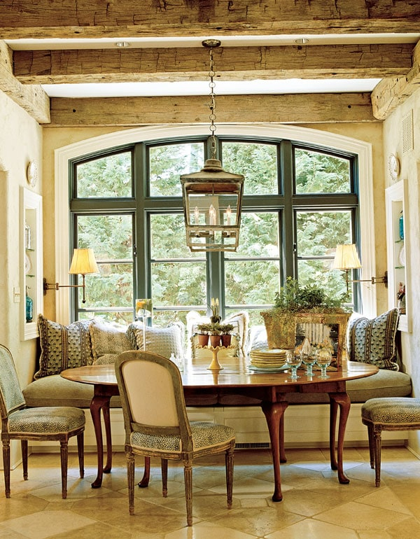kitchen banquette french country style eat-in breakfast area wood ceiling beams antique lantern stunning space