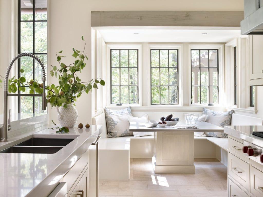 kitchen banquette white room modern farmhouse style black steel windows