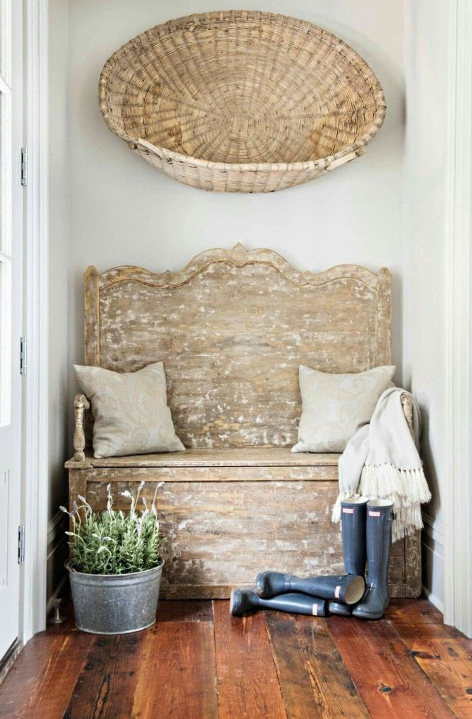 antique baskets hanging on wall as art over entry way bench lovely farmhouse style
