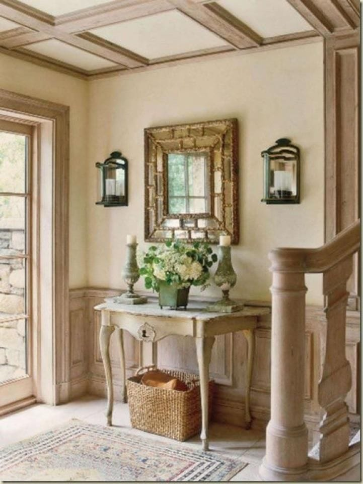 antique baskets entry way under console table french country style gold mirror sconces