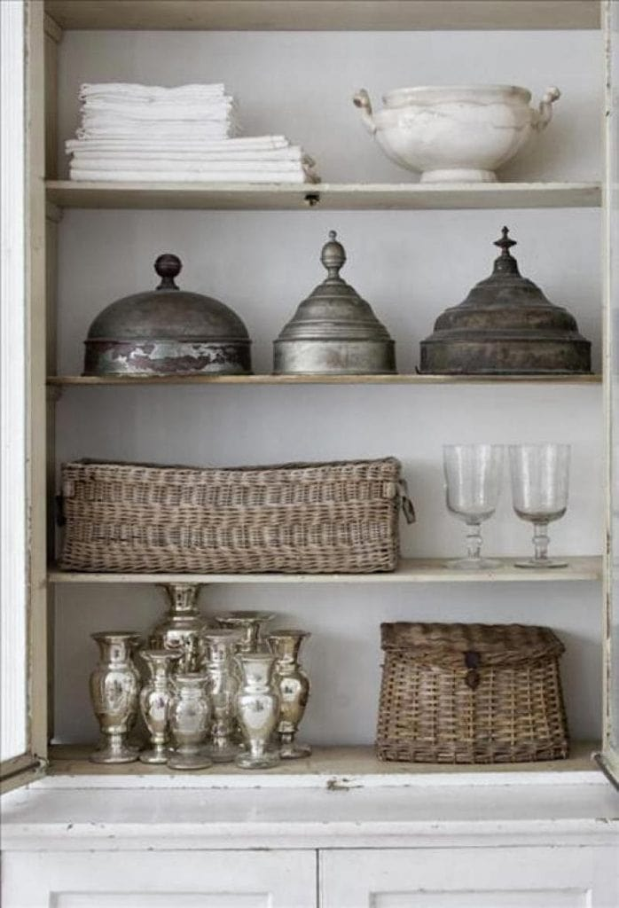 vintage baskets shelf styling with pewter ironstone and mercury glass gorgeous vintage vignette