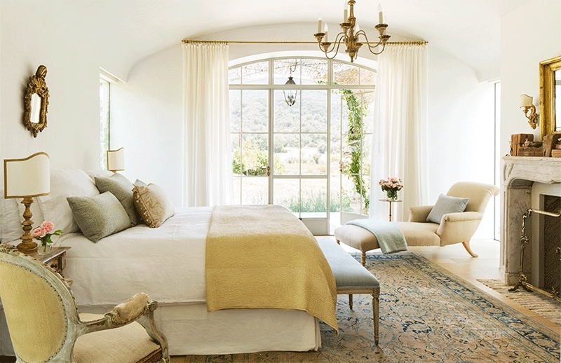 neutral rooms master bedroom with touches of gold and soft greens gold mirror and chandelier stunning windows