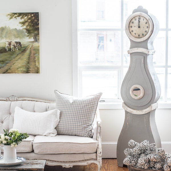 neutral rooms white sofa mora clock pretty landscape painting