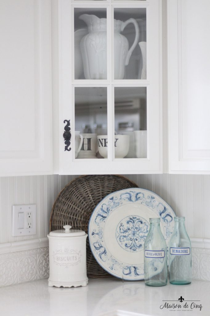 mixing vintage decor with new white farmhouse kitchen glass cabinets white ironstone pitchers blue and white platter