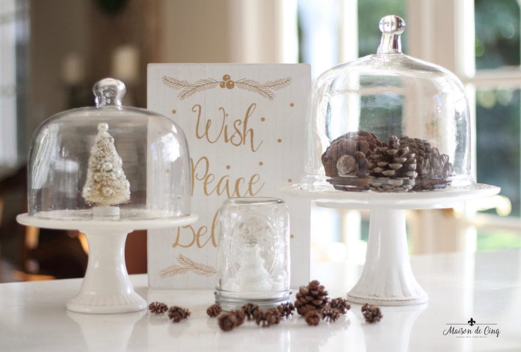 decorating cloches pinecones under glass christmas tree holiday decor countertop vignette