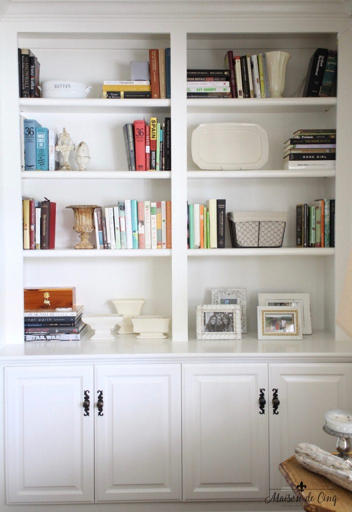 mixing vintage decor with new white bookshelves builtins family room french country farmhouse style