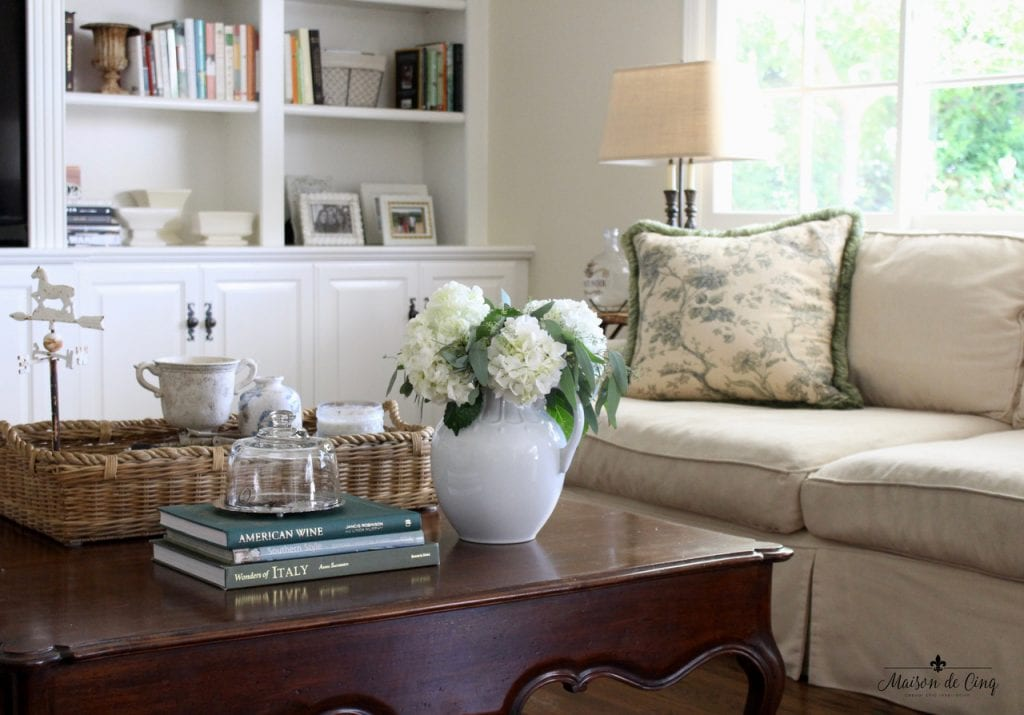 mixing vintage decor with new family room french country style coffee table books flowers in ironstone pitcher