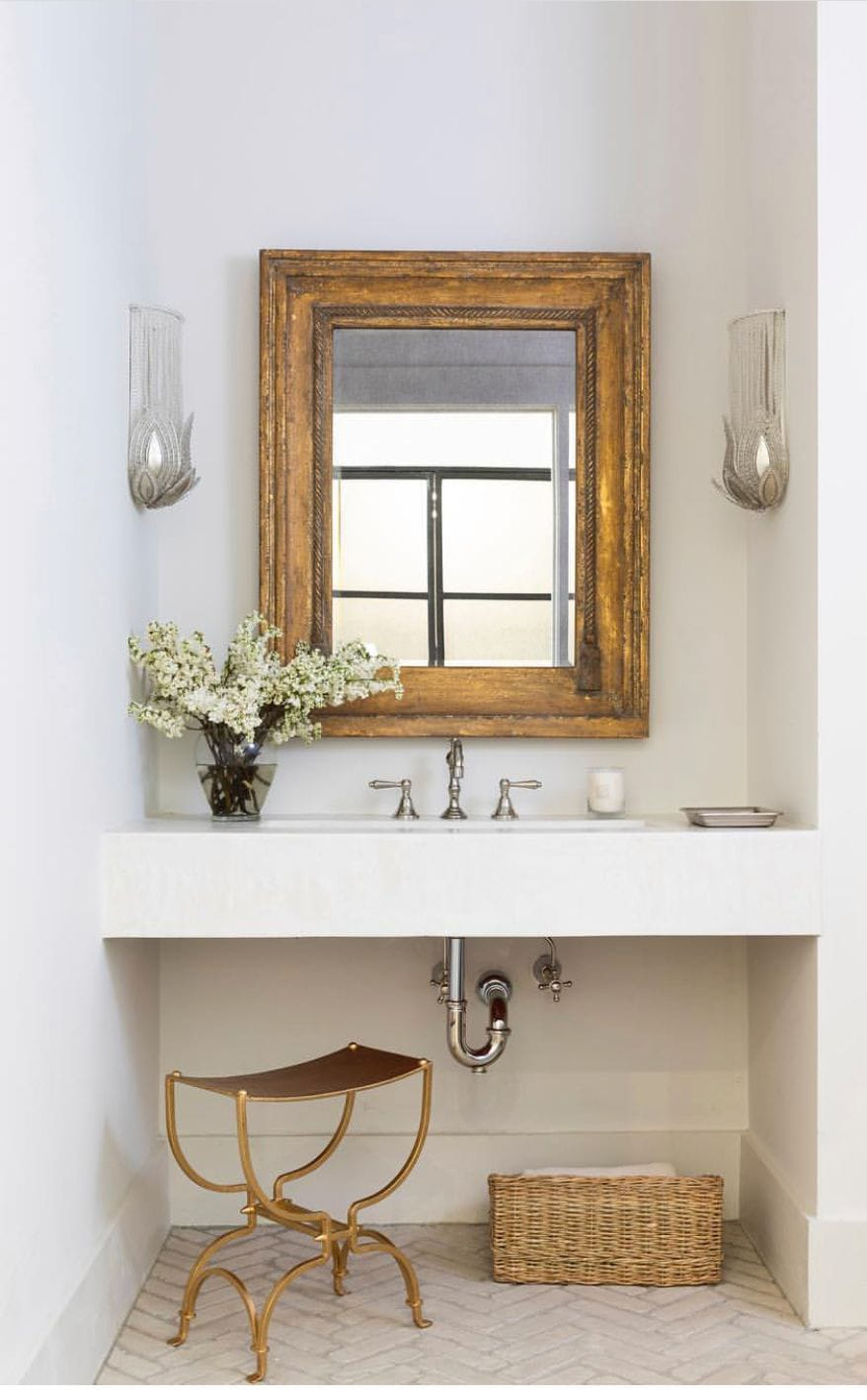 fabulous antique gold mirror in contemporary bathroom